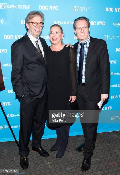 Eric Clapton Lili Fini Zanuck and Thom Powers attend the 2017 DOC NYC closing night screening of 'Eric Clapton Life In 12 Bars' at SVA Theatre on...