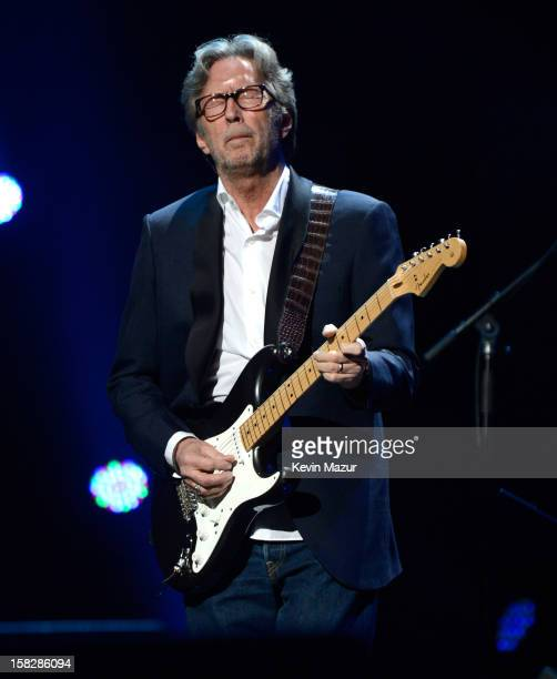 Eric Clapton performs at 121212 a concert benefiting The Robin Hood Relief Fund to aid the victims of Hurricane Sandy presented by Clear Channel...