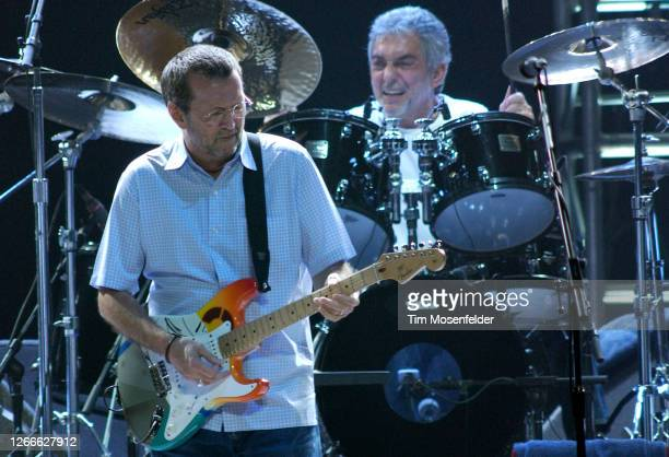"""Eric Clapton performs in support of his """"Me and Mr. Johnson"""" release at HP Pavilion on July 30, 2004 in San Jose, California."""