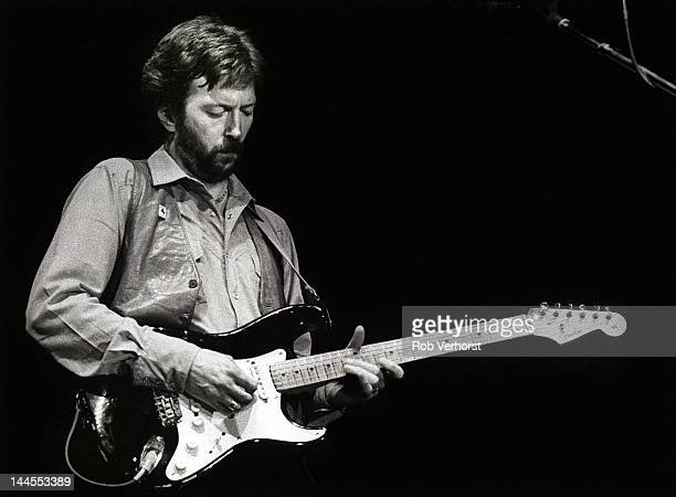 Eric Clapton performs on stage at Ahoy, Rotterdam, Netherlands, 23rd April 1983. He plays a Fender Stratocaster guitar.
