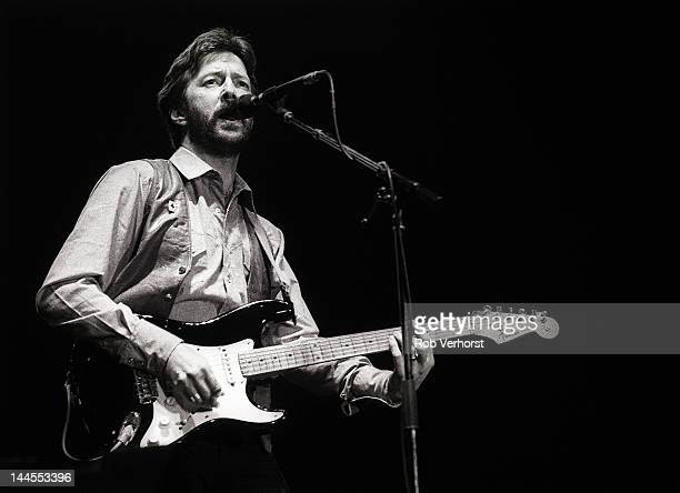 Eric Clapton performs on stage at Ahoy Rotterdam Netherlands 23rd April 1983 He plays a Fender Stratocaster guitar