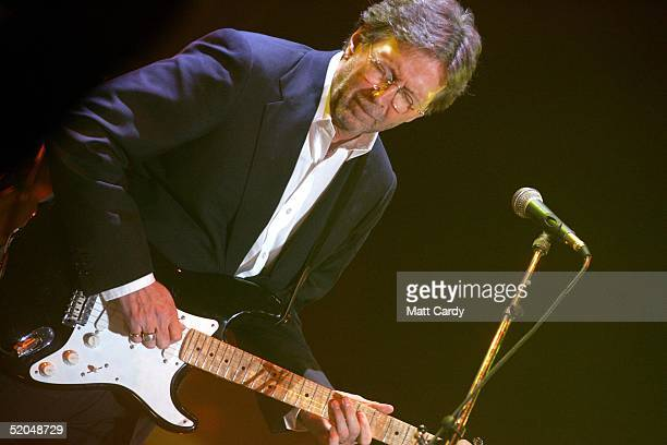 Eric Clapton performs on stage at the Tsunami Disaster Fundraising Concert at the Millennium Stadium on January 22 2005 in Cardiff WalesThe concert...