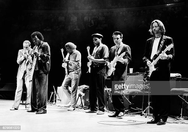 Eric Clapton performs on stage with blues musicians at the Royal Albert Hall London 1991 LR Jerry Portnoy Buddy Guy Albert Collins Robert Cray Jimmie...