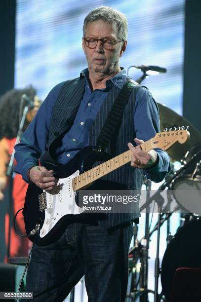 Eric Clapton performs onstage with his band at Madison Square Garden on March 19 2017 in New York City