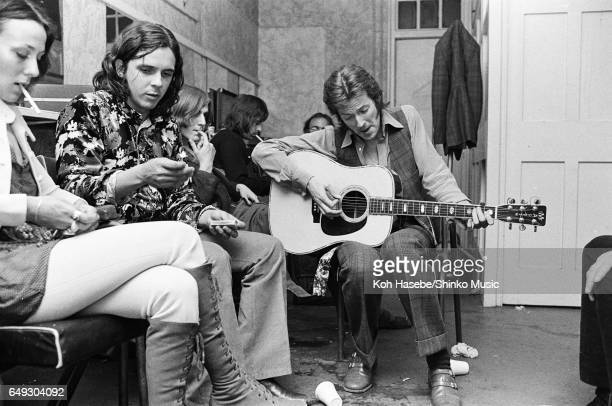 Eric Clapton playing accoustic guitar in the dressing room of Lyceum Ballroom June 14th 1970