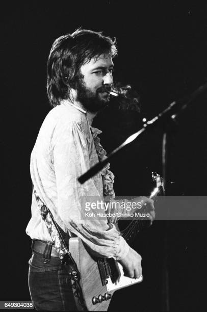 Eric Clapton playing and smoking a cigarette at Nippon Budokan October 31th 1974