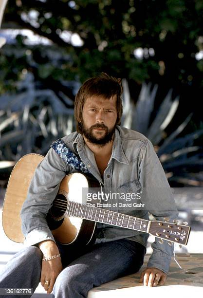 Eric Clapton poses for a portrait at his rented home at 461 Ocean Blvd in April 1974 in Golden Beach Florida
