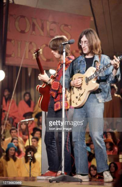 Eric Clapton the English rock and blues guitarist singer and songwriter and John Lennon the English singer songwriter peace activist and colead...