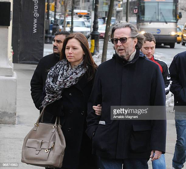 Eric Clapton walks with his wife Melia on Madison Avenue on February 19 2010 in New York City