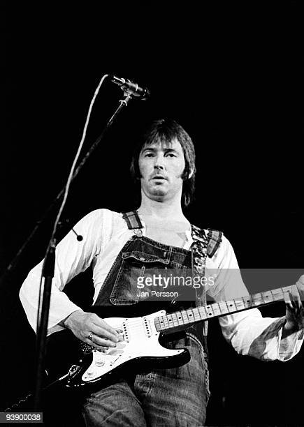 Eric Clapton wearing dunagrees performs on stage at KB Hallen on June 20th 1974 in Copenhagen Denmark He plays a Fender Telecaster guitar He plays...