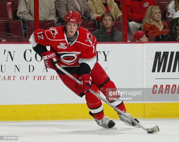 Eric Cole of the Carolina Hurricanes carries the puck against the New York Islanders during their NHL game on December 31, 2007 at RBC Center in...