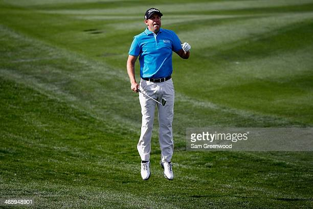 Eric Compton jumps on the 9th hole during the first round of the Waste Management Phoenix Open at TPC Scottsdale on January 30 2014 in Scottsdale...