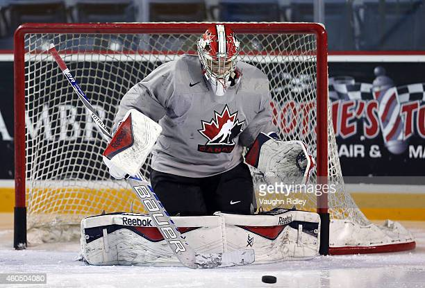 Eric Comrie faces shots during the Canada National Junior Team practice at the Meridian Centre on December 15 2014 in St Catharines Ontario Canada