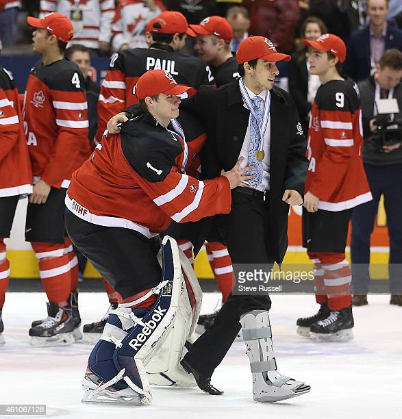 TORONTO ON JANUARY 5 Eric Comrie helps Robby Fabbri as Team Canada beats Team Russia 54 to win the Gold Medal in the IIHF World Junior Hockey...