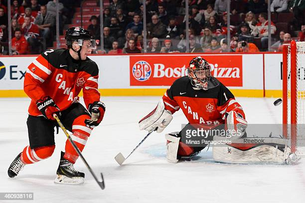Eric Comrie of Team Canada and teammate Joe Hicketts watch as the puck goes wide of the net in a preliminary round game during the 2015 IIHF World...