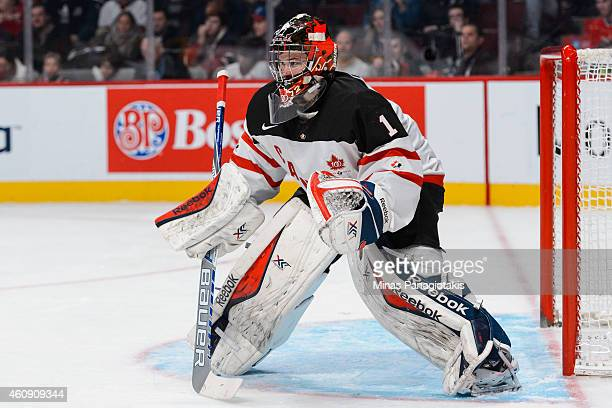 Eric Comrie of Team Canada follows the play during the 2015 IIHF World Junior Hockey Championship game against Team Germany at the Bell Centre on...