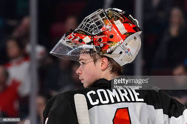 Eric Comrie of Team Canada looks on during stoppage of play at the 2015 IIHF World Junior Hockey Championship game against Team Germany at the Bell...