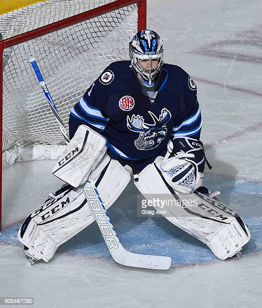 Eric Comrie of the Manitoba Moose prepares for a shot against the Toronto Marlies during AHL game action on December 5 2015 at the Ricoh Coliseum in...