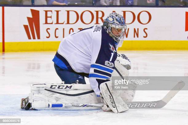 Eric Comrie of the Winnipeg Jets makes a save while making his NHL debut during the game against the Columbus Blue Jackets on April 6 2017 at...