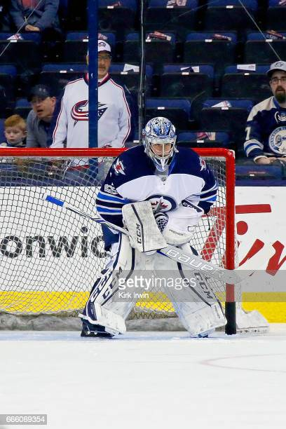Eric Comrie of the Winnipeg Jets warms up prior to making his NHL debut during the game against the Columbus Blue Jackets on April 6 2017 at...