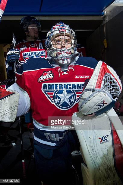 Eric Comrie of TriCity Americans kneels in the tunnel outside the dressing room and mentally prepares to enter the ice against the Kelowna Rockets on...