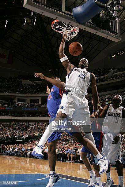 Eric Dampier of the Dallas Mavericks dunks the ball against the Detroit Pistons on December 6 2004 at the American Airlines Center in Dallas Texas...