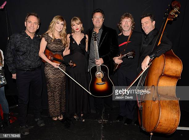 Eric Darken Alison KraussTaylor Swift Vince Gill Sam Bush and Edgar Myer pose backstage at the 47th annual CMA Awards at the Bridgestone Arena on...