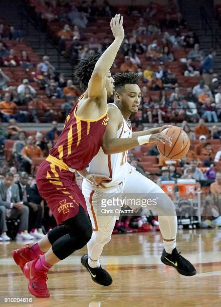 Eric Davis Jr #10 of the Texas Longhorns drives around Lindell Wigginton of the Iowa State Cyclones at the Frank Erwin Center on January 22 2018 in...