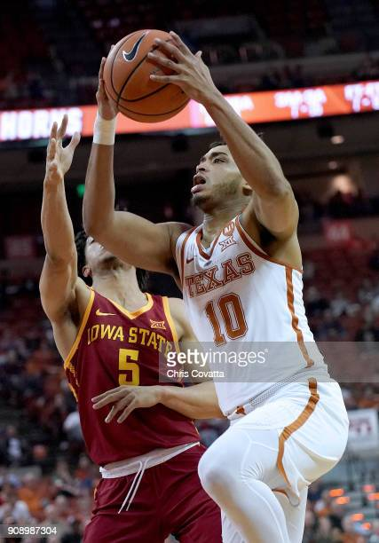 Eric Davis Jr #10 of the Texas Longhorns leaps to the basket against Lindell Wigginton of the Iowa State Cyclones at the Frank Erwin Center on...