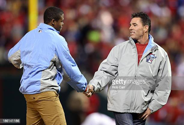 Eric Davis Jr and former Cardinal Jim Edmonds deliver the game ball prior to Game Five of the 2013 World Series between the St Louis Cardinals and...