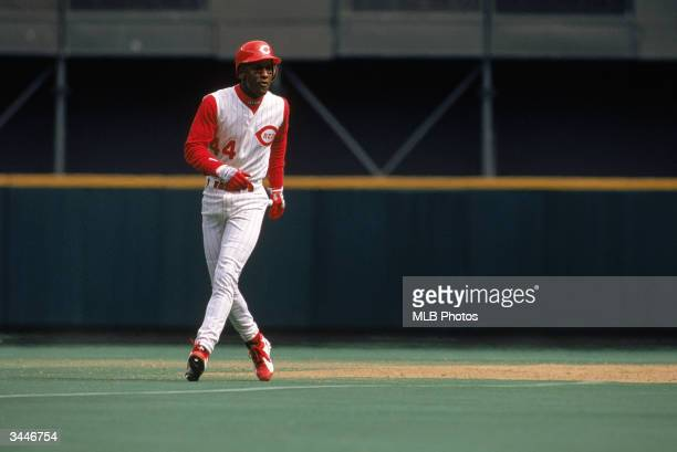 Eric Davis of the Cincinnati Reds leads off base during a game against the Houston Astros at Riverfront Stadium on April 14 1996 in Cincinnati Ohio...