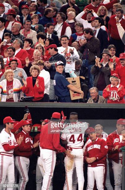 Eric Davis of the Cincinnati Reds receives congratulations from teammates after hitting a two run home run during Game one of the 1990 World Series...