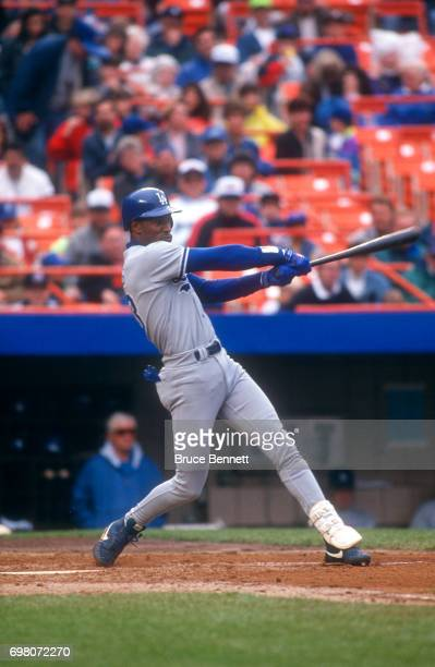 Eric Davis of the Los Angeles Dodgers swings at the pitch during an MLB game against the New York Mets on May 10 1992 at Shea Stadium in Flushing New...