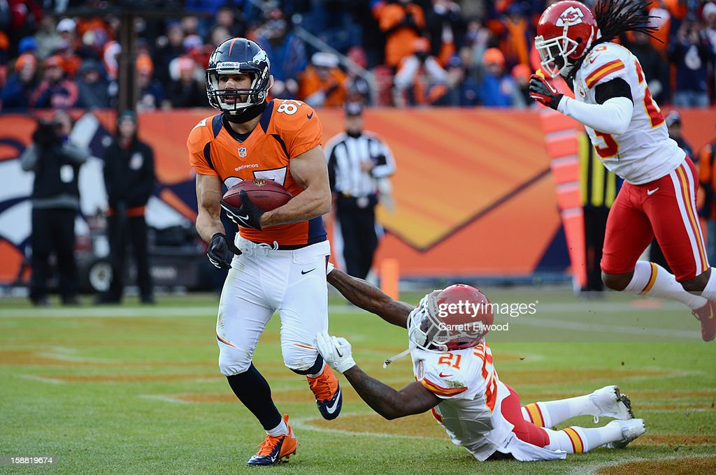 Eric Decker #87 of the Denver Broncos catches a touchdown pass during the game against the Kansas City Chiefs at Sports Authority Field at Mile High on December 30, 2012 in Denver, Colorado.