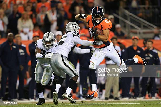 Eric Decker of the Denver Broncos completes a second quarter pass reception against DJ Hayden of the Oakland Raiders at Sports Authority Field at...