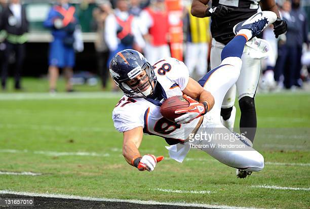 Eric Decker of the Denver Broncos dives into the endzone for a twenty seven yard touchdown catch against the Oakland Raiders at Oco Coliseum on...