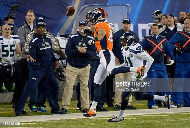 Eric Decker of the Denver Broncos leaps but can't come up with this pass defended by Byron Maxwell of the Seattle Seahawks during Super Bowl XLVIII...