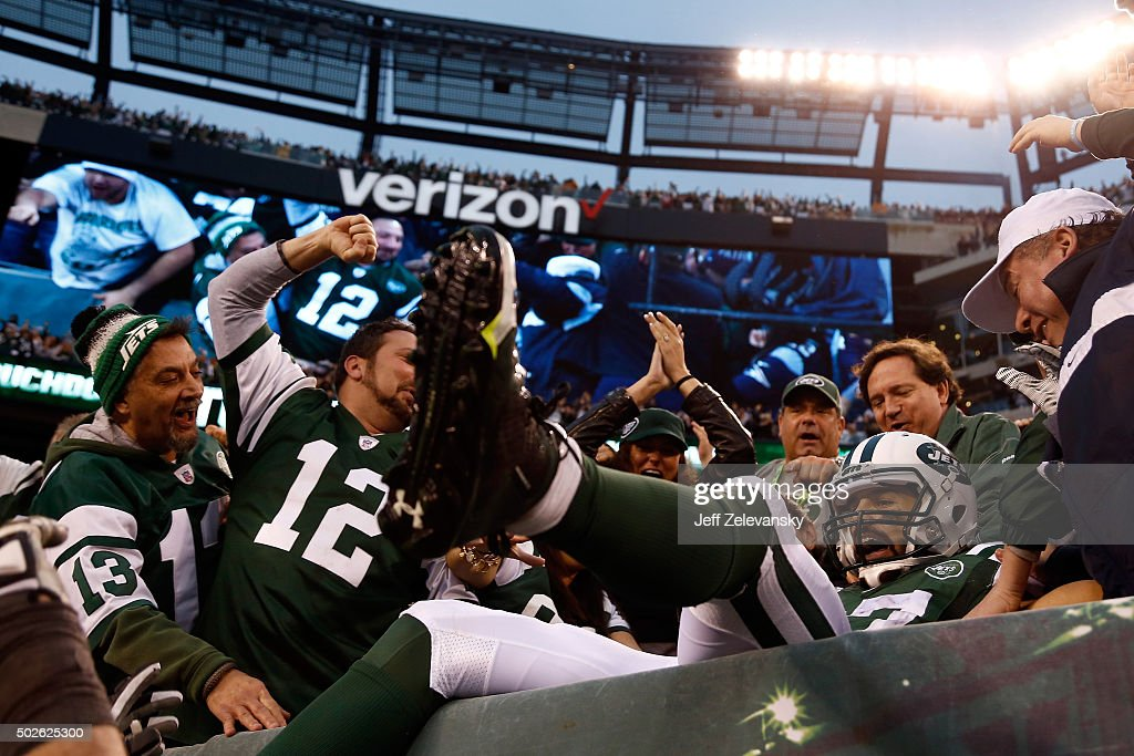 Eric Decker #87 of the New York Jets celebrates with fans in the stands after scoring the game winning touchdown in overtime against the New England Patriots in their game at MetLife Stadium on December 27, 2015 in East Rutherford, New Jersey. The Jets defeated the Patriots with a score of 26 to 20 in overtime.