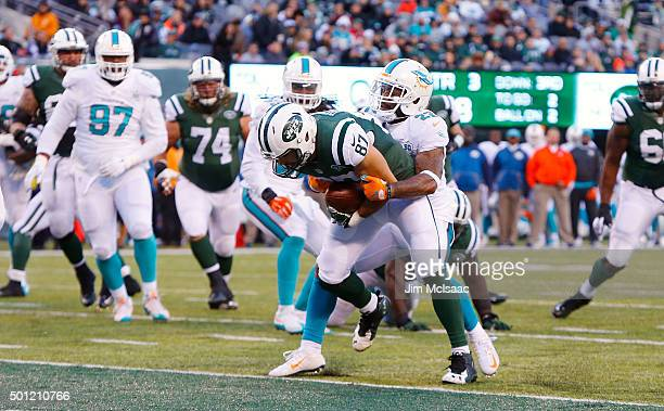 Eric Decker of the New York Jets runs in a touchdown against Jamar Taylor of the Miami Dolphins on November 29, 2015 at MetLife Stadium in East...