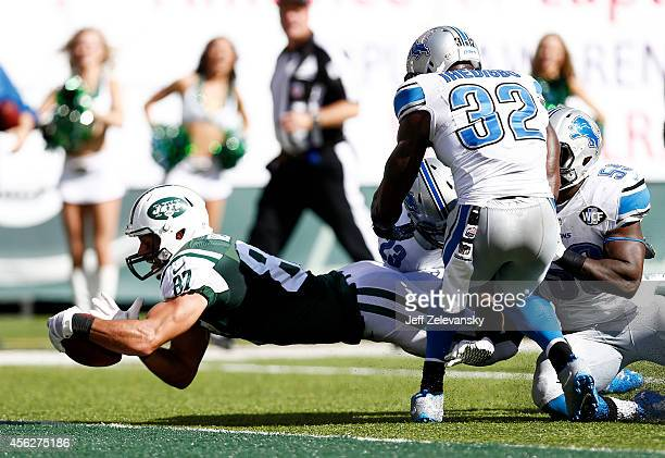 Eric Decker of the New York Jets scores a touchdown in the third quarter against the defense of Darius Slay and James Ihedigbo of the Detroit Lions...