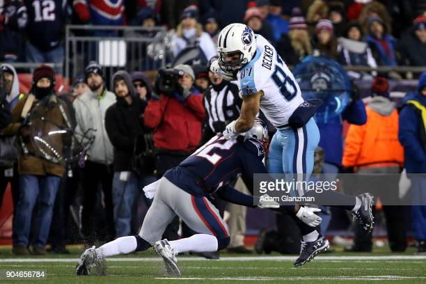 Eric Decker of the Tennessee Titans carries the ball after a catch as he is defended by Elandon Roberts of the New England Patriots during the second...