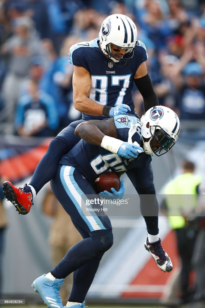 Eric Decker #87 of the Tennessee Titans celebratres with Delanie Walker #82 after a touchdown against the Houston Texans during the second half at Nissan Stadium on December 3, 2017 in Nashville, Tennessee.