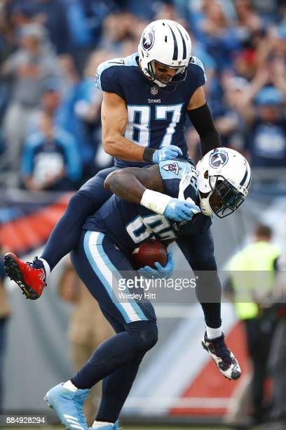 Eric Decker of the Tennessee Titans celebratres with Delanie Walker after a touchdown against the Houston Texans during the second half at Nissan...