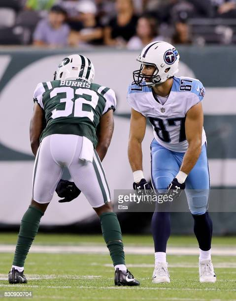 Eric Decker of the Tennessee Titans lines up against his former teammate Juston Burris of the New York Jets during a preseason game at MetLife...