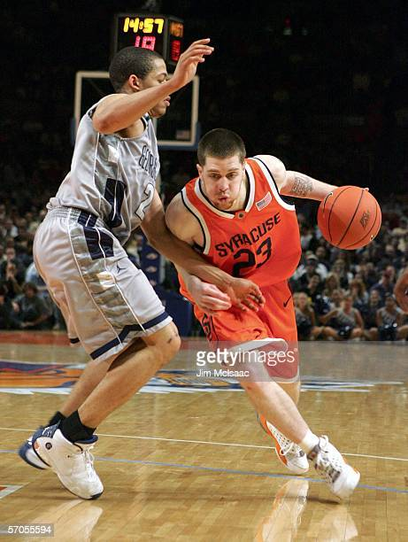 Eric Devendorf of the Syracuse Orange drives to the basket against Jonathan Wallace of the Georgetown Hoyas during the semifinals of the Big East...
