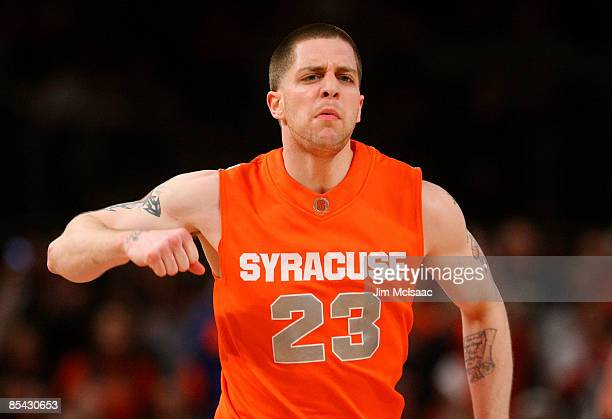 Eric Devendorf of the Syracuse Orange reacts between plays against the Louisville Cardinals during the championship game of the Big East Tournament...