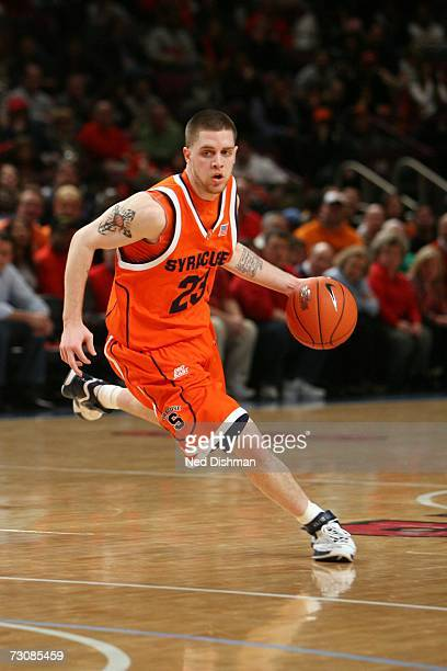 Eric Devendorf of the Syracuse University Orange drives against the St. John's University Red Storm at Madison Square Garden on January 21, 2007 in...