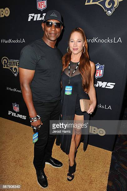 Eric Dickerson and Penny Sutton arrive at the Premiere of HBO and NFL Films 'Hard Knocks Training Camp With The Los Angeles Rams' at Regal LA Live...