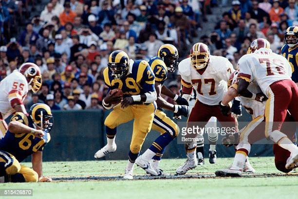 Eric Dickerson, halfback for the Los Angeles Rams, carrying the ball in a game against the Washington Redskins.