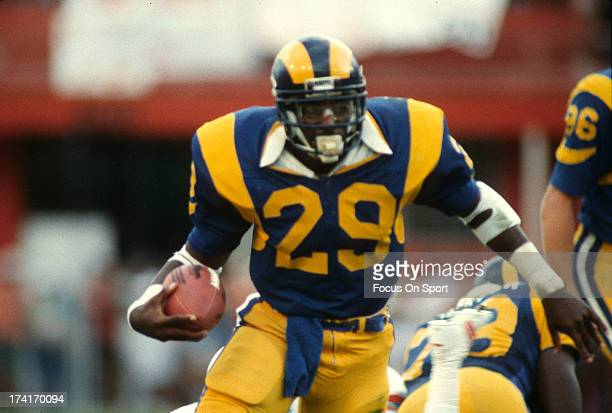 Eric Dickerson of the Los Angeles Rams carries the ball against the Houston Oilers during an NFL football game December 9 1984 at Anaheim Stadium in...